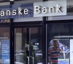 Через банк в Эстонии